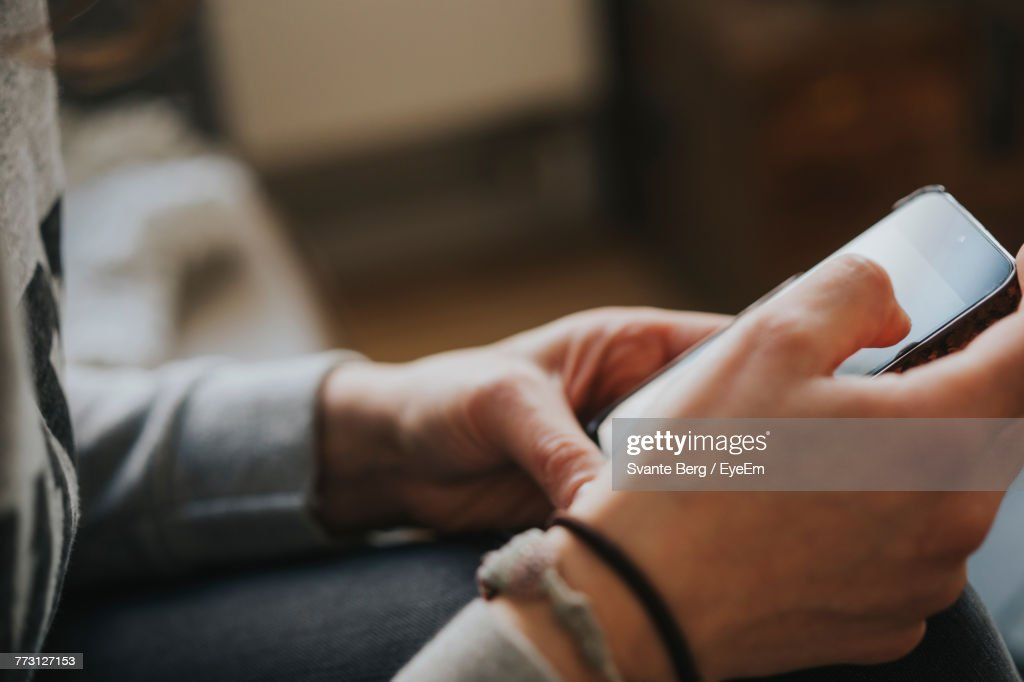 Cropped Hands Of Woman Using Mobile Phone : Photo