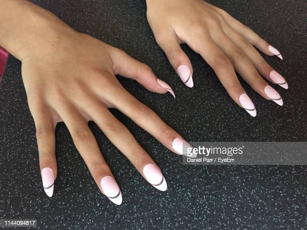cropped hands of woman with nail art on fingernails - streatham stock pictures, royalty-free photos & images