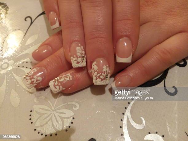 Cropped Hands Of Woman With Nail Polish