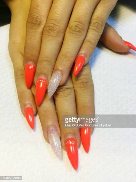 cropped hands of woman with painted nails - nail art stock photos and pictures