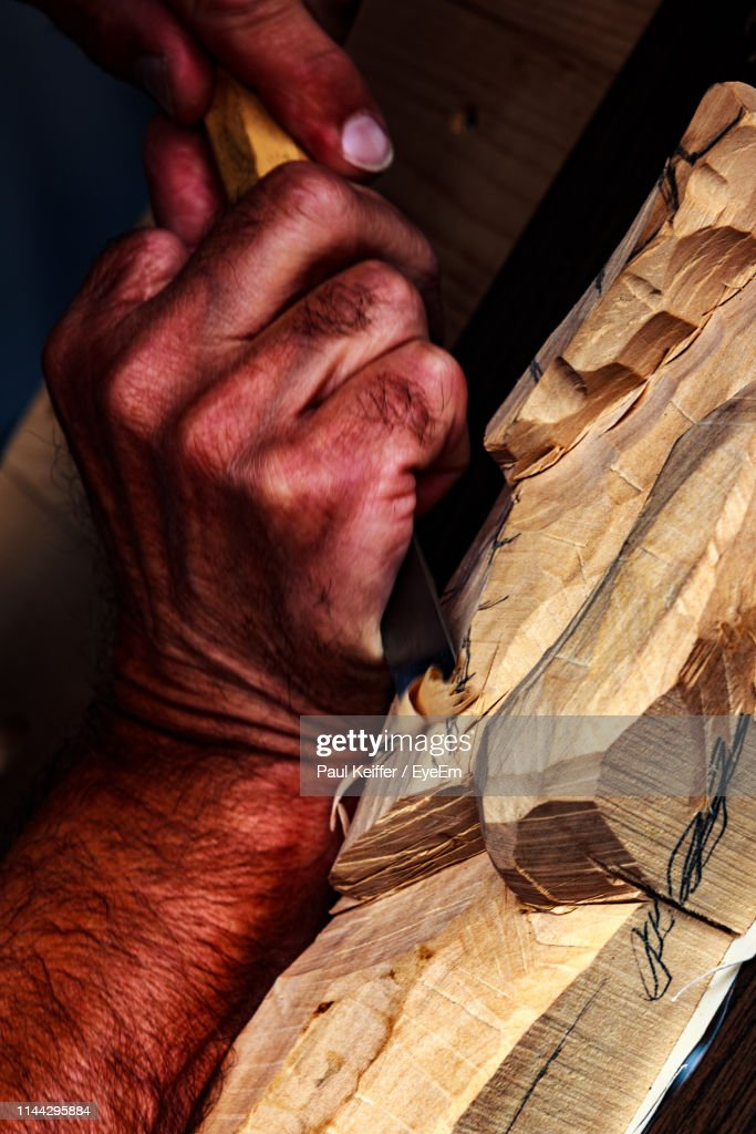 Cropped Hands Of Worker Holding Wood In Workshop : Stock Photo