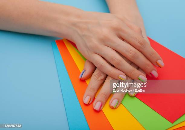 cropped hands on colorful papers - nail art stock pictures, royalty-free photos & images