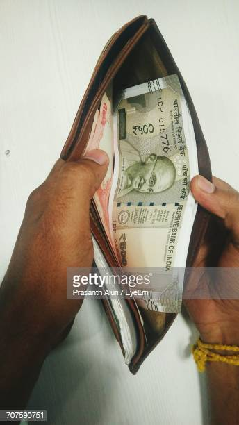 Cropped Hands On Man Holding Wallet With Indian Five Hundred Ru Note In It