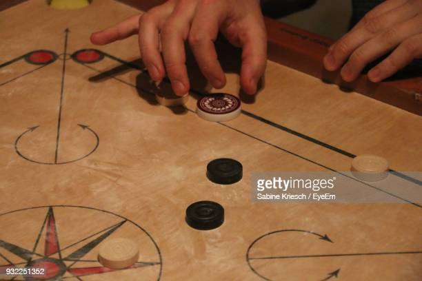 Cropped Hands Playing Carrom