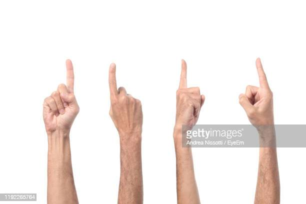 cropped hands pointing over white background - pointing stock pictures, royalty-free photos & images