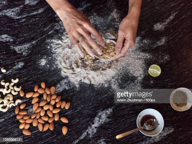cropped hands preparing food on table, pokhara, nepal - pokhara stock pictures, royalty-free photos & images