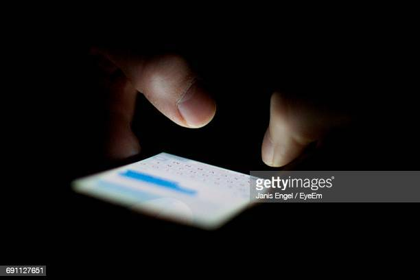 cropped hands typing on mobile phone in dark - text stock pictures, royalty-free photos & images