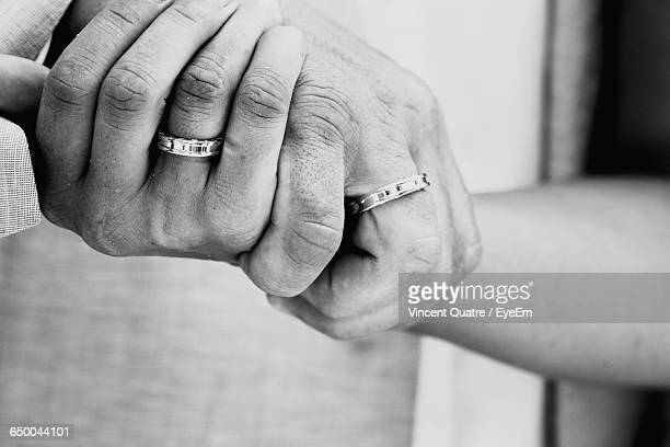 Cropped Hands With Engagement Ring