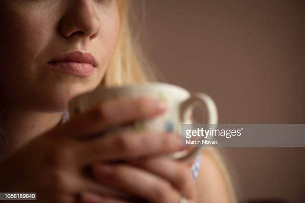 cropped image of a woman having coffee - addict stock photos and pictures