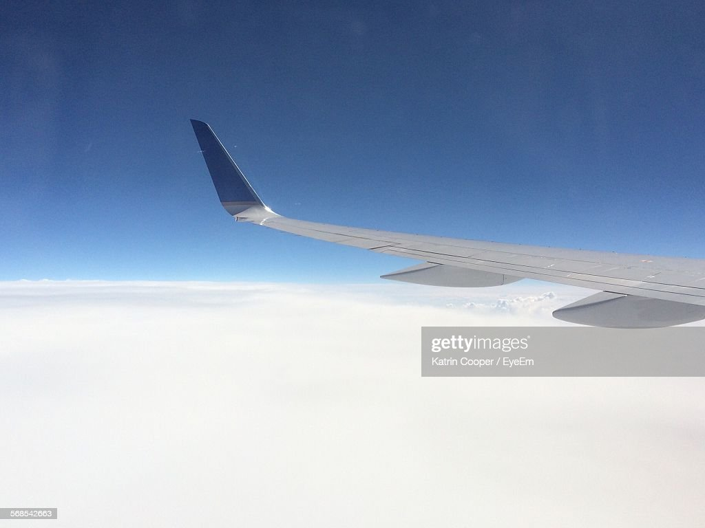 Cropped Image Of Airplane Against Clear Blue Sky : Stock Photo
