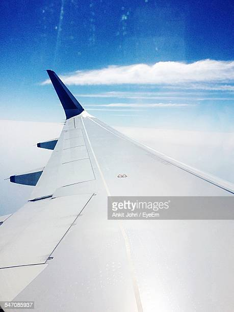 Cropped Image Of Airplane Flying In Sky