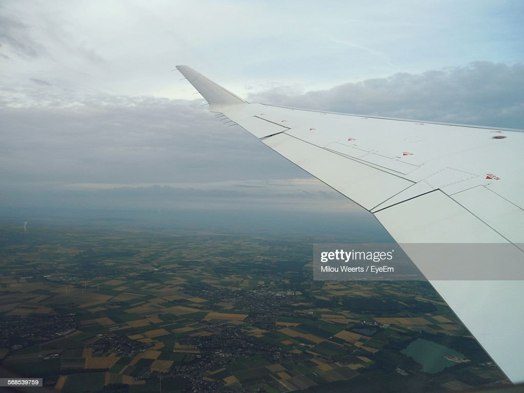 Cropped Image Of Airplane Flying In Sky : Stock Photo