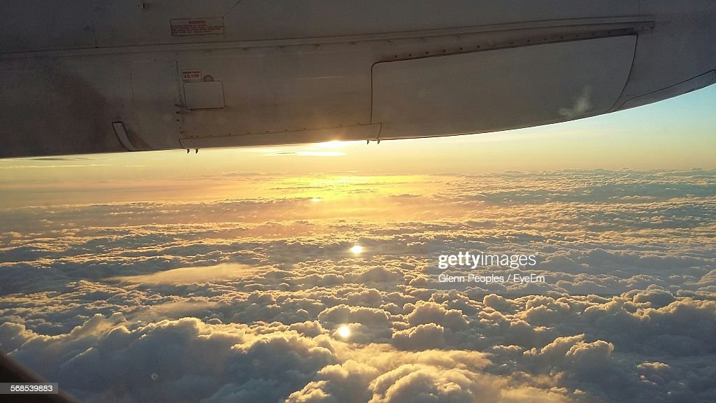Cropped Image Of Airplane Flying Over Cloudy Sky : Stock Photo