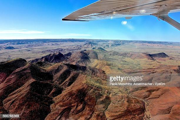 Cropped Image Of Airplane Over Purnululu National Park Against Blue Sky
