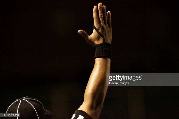 cropped image of american football referee signaling touchdown - american football judge stock pictures, royalty-free photos & images