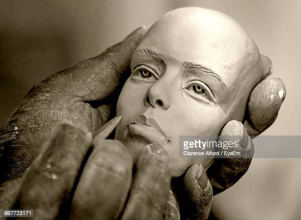 Cropped Image Of Artist Making Human Sculpture