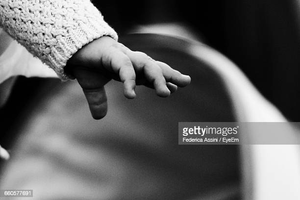cropped image of baby hand - unknown gender stock pictures, royalty-free photos & images