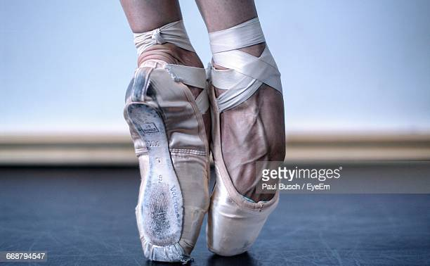 cropped image of ballet dancer - ballet dancer stock pictures, royalty-free photos & images