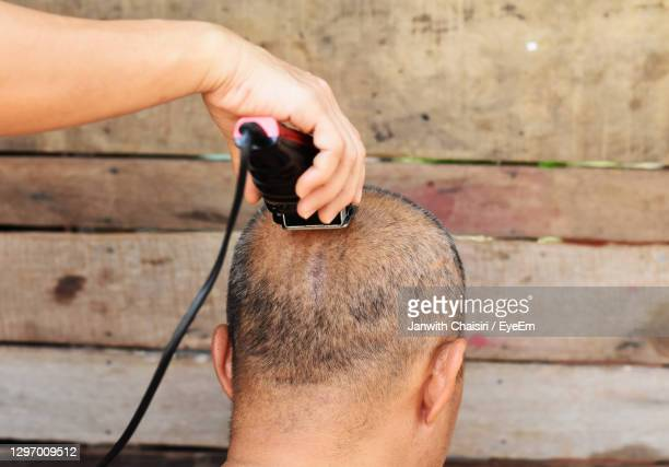cropped image of barber shaving head of man outdoors - shaved stock pictures, royalty-free photos & images