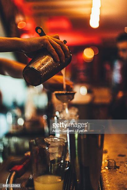 Cropped Image Of Bartender Making Cocktail In Bar
