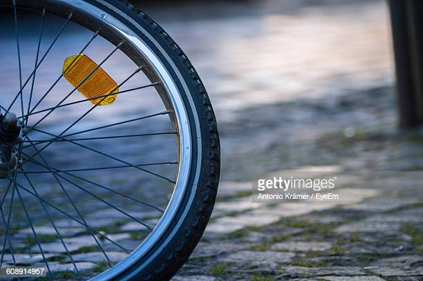 Cropped Image Of Bicycle On Cobblestone Street