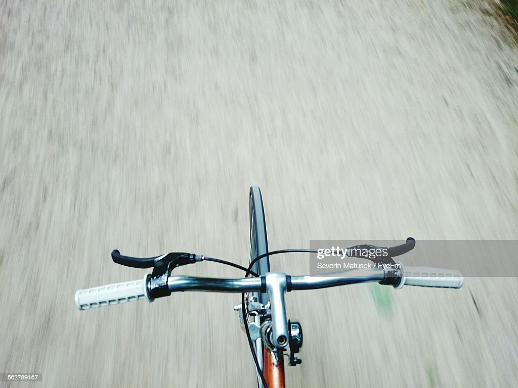 Cropped Image Of Bicycle On Road : Stock Photo