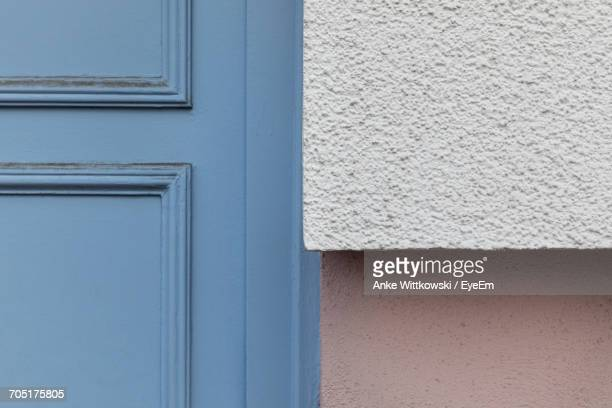 Cropped Image Of Blue Door By Wall