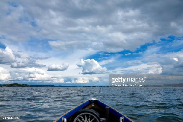 Cropped Image Of Boat In Sea Against Cloudy Sky