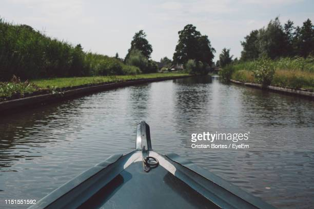 cropped image of boat on lake against trees - overijssel stock pictures, royalty-free photos & images