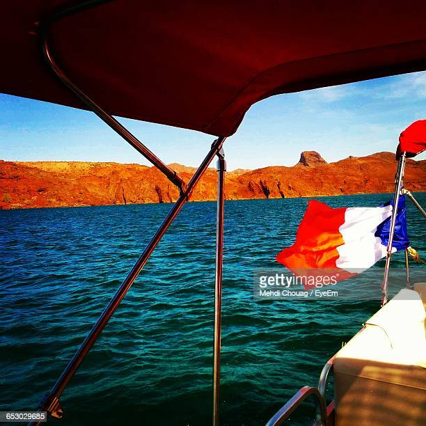 cropped image of boat sailing in sea - lake havasu stock photos and pictures