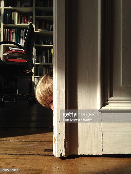 Cropped Image Of Boy Hiding At Home