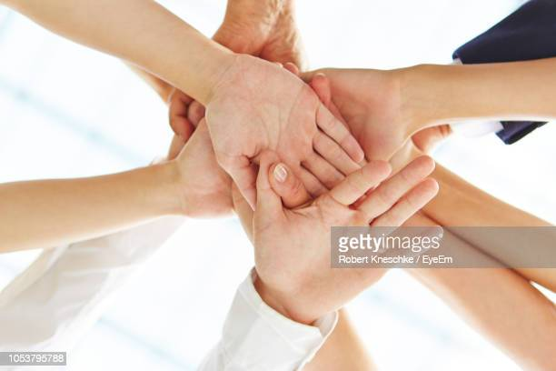 cropped image of business people joining hands - 絆 ストックフォトと画像