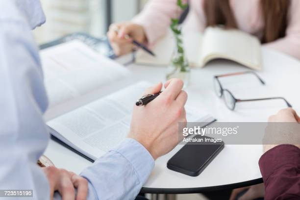 Cropped image of business people planning on table in office