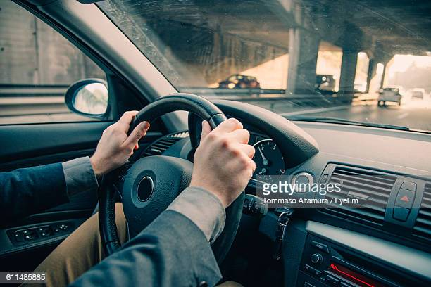 Cropped Image Of Businessman Driving In Car