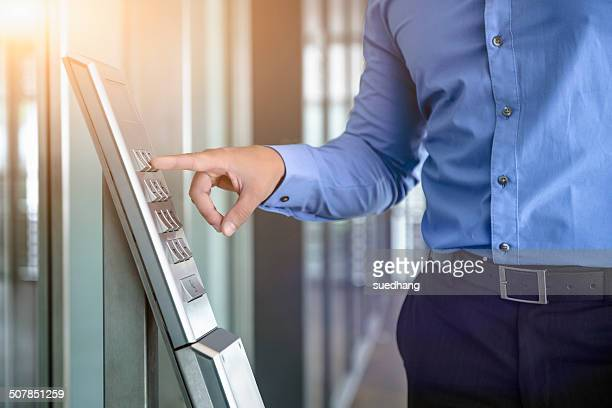 Cropped image of businessman typing in office security code office window
