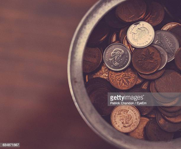 cropped image of canadian pennies in container - canadian currency stock pictures, royalty-free photos & images