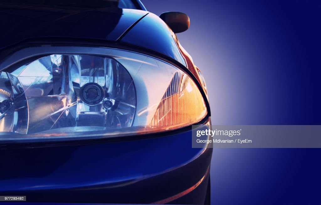 Cropped Image Of Car Against Blue Background : Stock Photo
