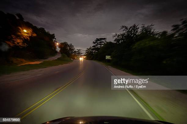 cropped image of car on highway - andres ruffo stock pictures, royalty-free photos & images