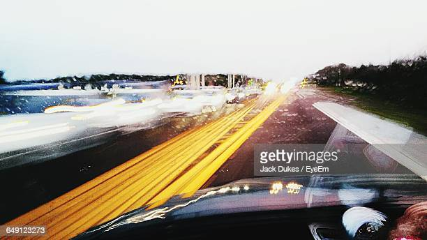 cropped image of car on road against clear sky - plant city stock pictures, royalty-free photos & images