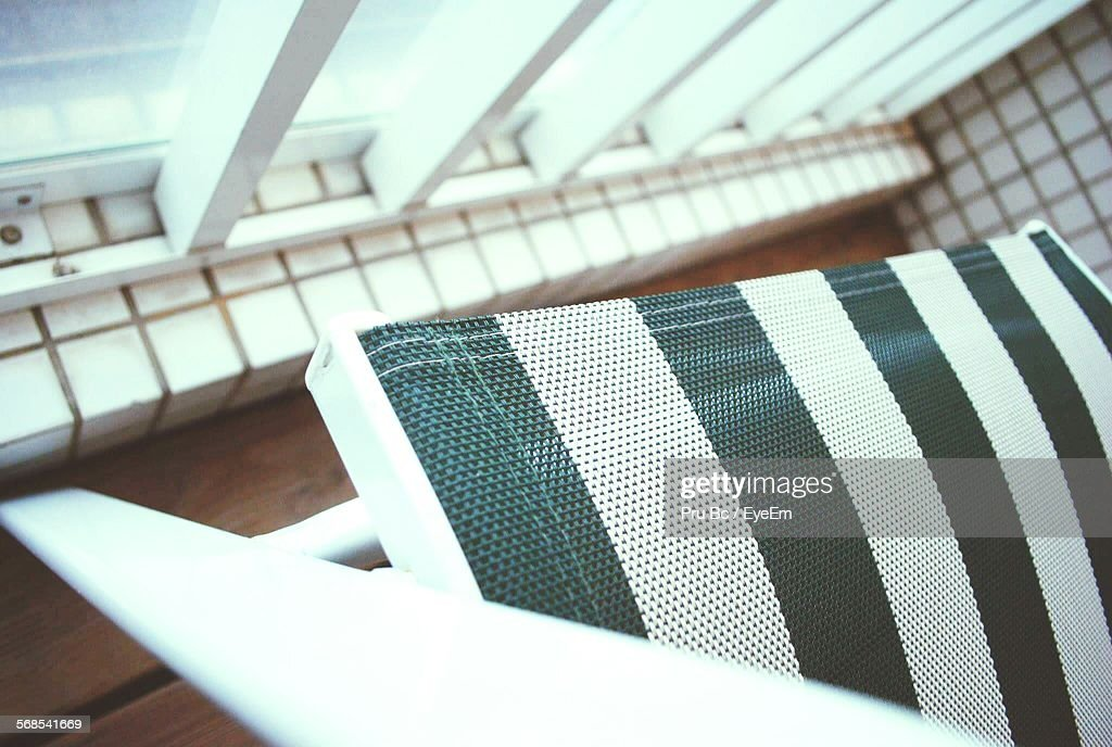 Cropped Image Of Chair In Balcony : Stock Photo
