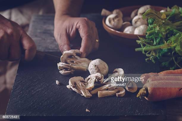 Cropped Image Of Chef Cutting Mushroom