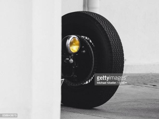 Cropped Image Of Classic Car Tire By Wall