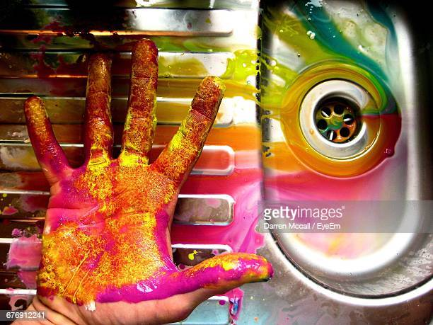 Cropped Image Of Colorful Messy Hand By Sink At Home