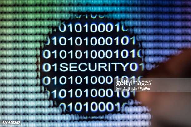 Cropped Image Of Computer Hacker With Binary Codes