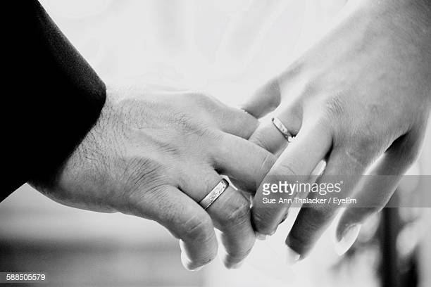 Cropped Image Of Couple Hands With Wedding Rings