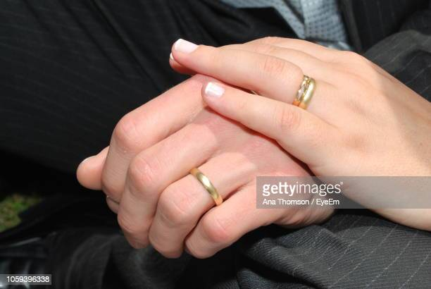 cropped image of couple wearing engagement rings - wedding ring stock pictures, royalty-free photos & images