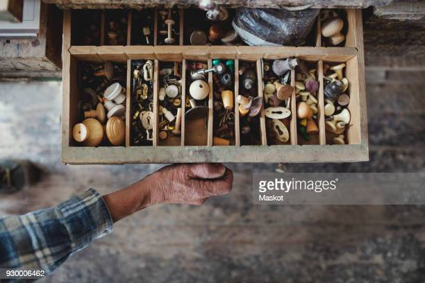 cropped image of craftsperson opening drawer with knobs at workshop - drawer stock pictures, royalty-free photos & images