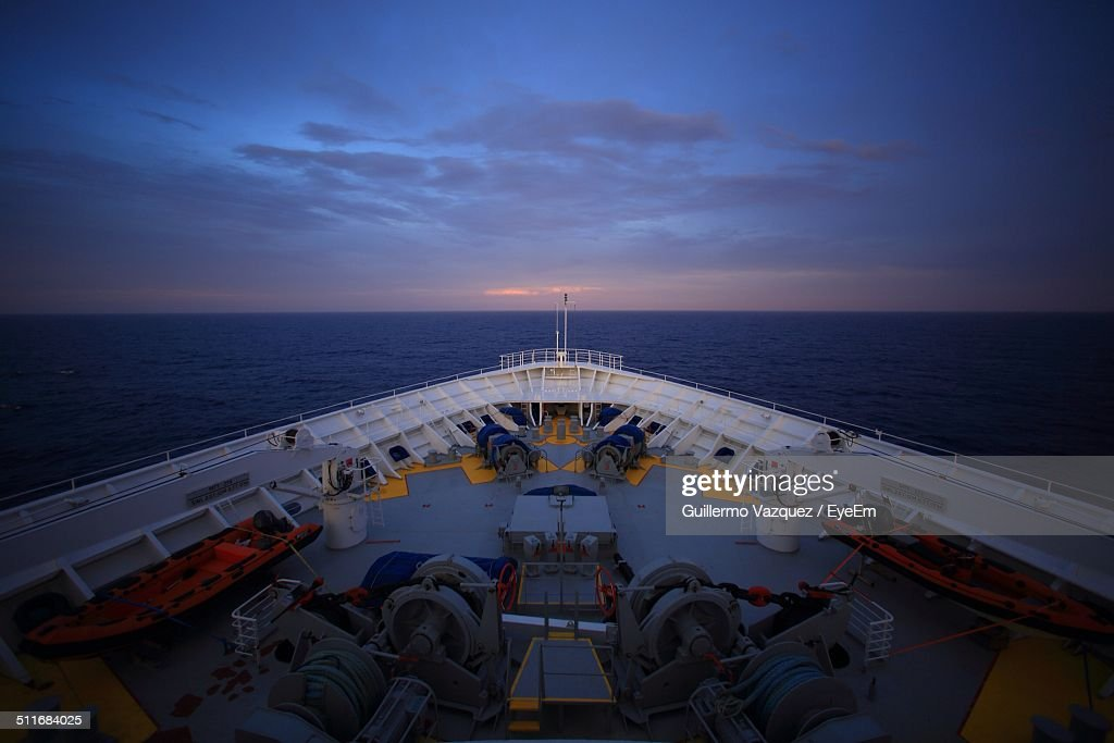 Cropped image of cruise ship in sea against sky at dusk : Stock Photo