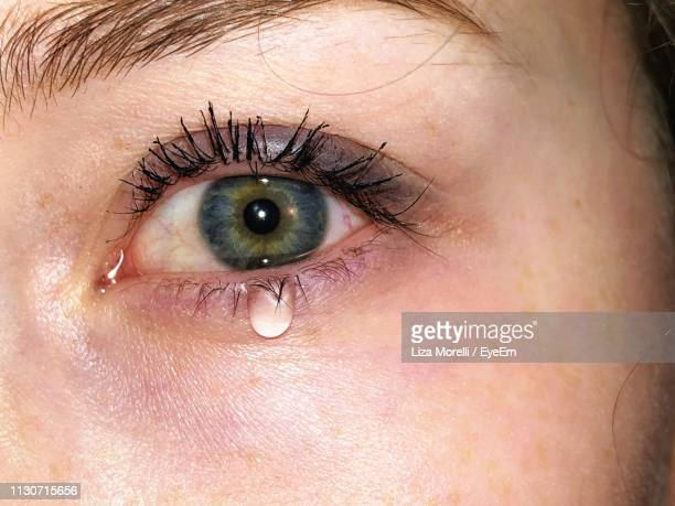 cropped image of crying woman - tear stock pictures, royalty-free photos & images