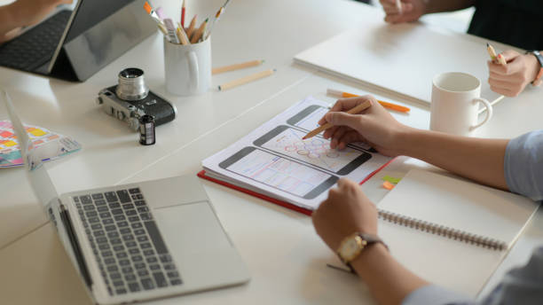 cropped image of designers drawing interface design for mobile phones picture